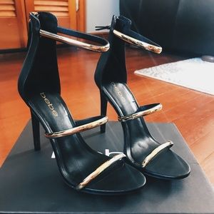 Bebe Black and Gold Strap Heels. Size 7.5